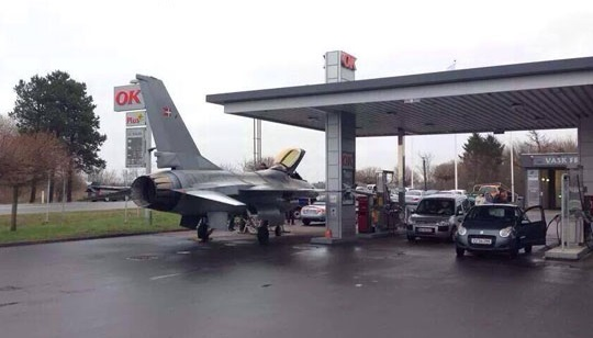 funny-picture-plane-charging-gas-station